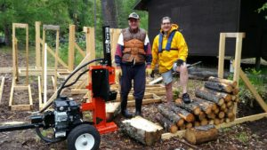 Bill stands proudly after splitting the first block of wood with the new Bear Cat.  The machine can be used with the hydraulic ram horizontal or vertical as in this photo.  Many thanks to Bill and the kind people of the Castlegar Rotary Clubs who made this possible.  Thanks, Don, for hauling the splitter over and for taking away a trailer load of junk.