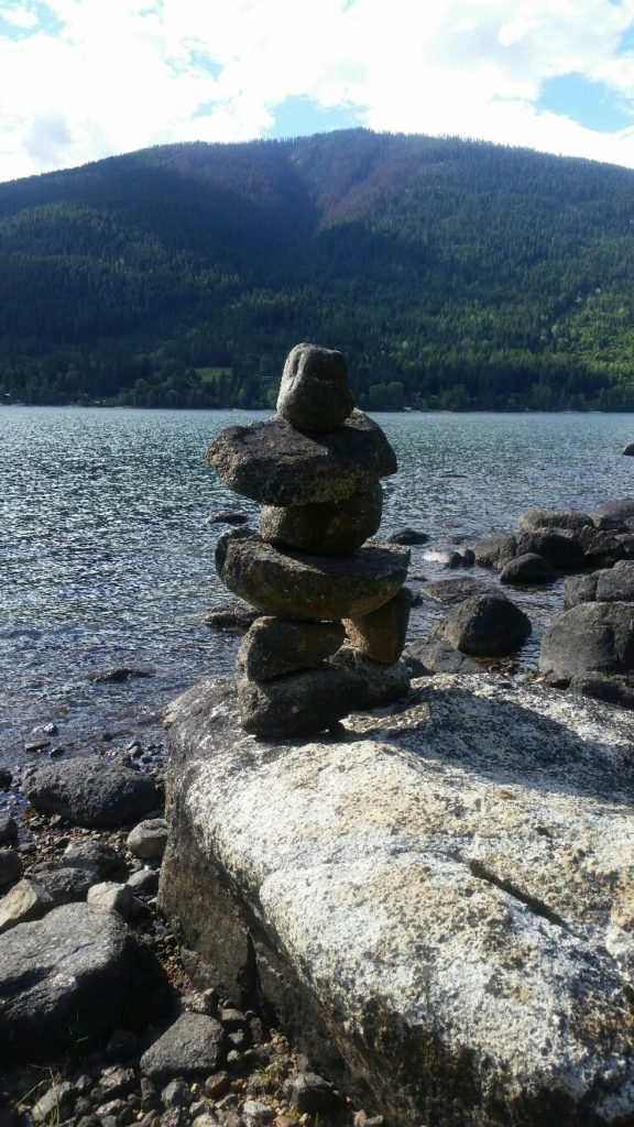 That looks like one of Jacob's Plett's inukshuks on the rocky shoreline near the Koolaree wharf.